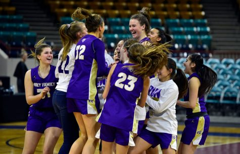DENVER, CO - The Holy Family High School girls celebrate victory over Green Mountain during a CHSAA State Semifinal game on Thursday at the Denver Coliseum. (Photo by Jeremy Papasso/Staff Photographer)