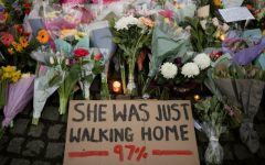 A sign is seen as people gather at a memorial site in Clapham Common Bandstand, following the kidnap and murder of Sarah Everard, in London, Britain March 13, 2021. REUTERS/Hannah McKay     TPX IMAGES OF THE DAY