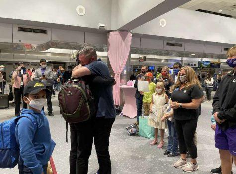 Scott Henkel and Ahmad Siddiqi embracing at DIA(Photo via the Henkel Family)